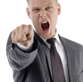 shouting adult boss pointing at camera on an isolated background